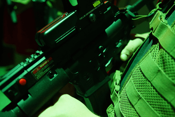 Player holding laser tagger tactical sight